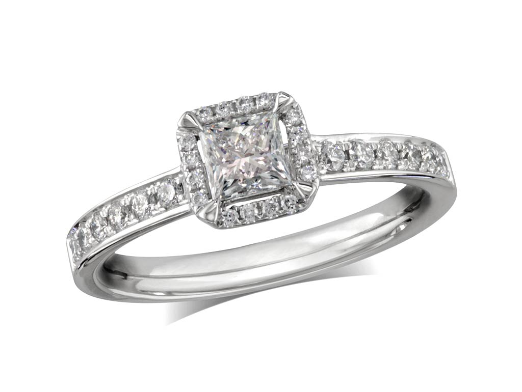 Exclusively created for PORTFOLIO of Fine Diamonds by Andrew Geoghegan, this platinum ring is set with a certified princess cut diamond held by talon-like faceted claws, surrounded by quatrefoil of white diamonds. Perfect fit with a wedding ring. Total cluster diamond weight: