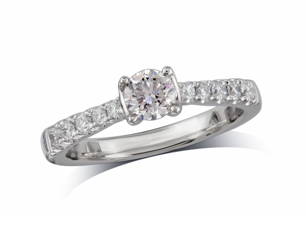 Platinum set single stone diamond engagement ring, with a certificated brilliant cut centre in a four claw setting, and diamond set shoulders. Perfect fit with a wedding ring. Total diamond weight: 0.57cts