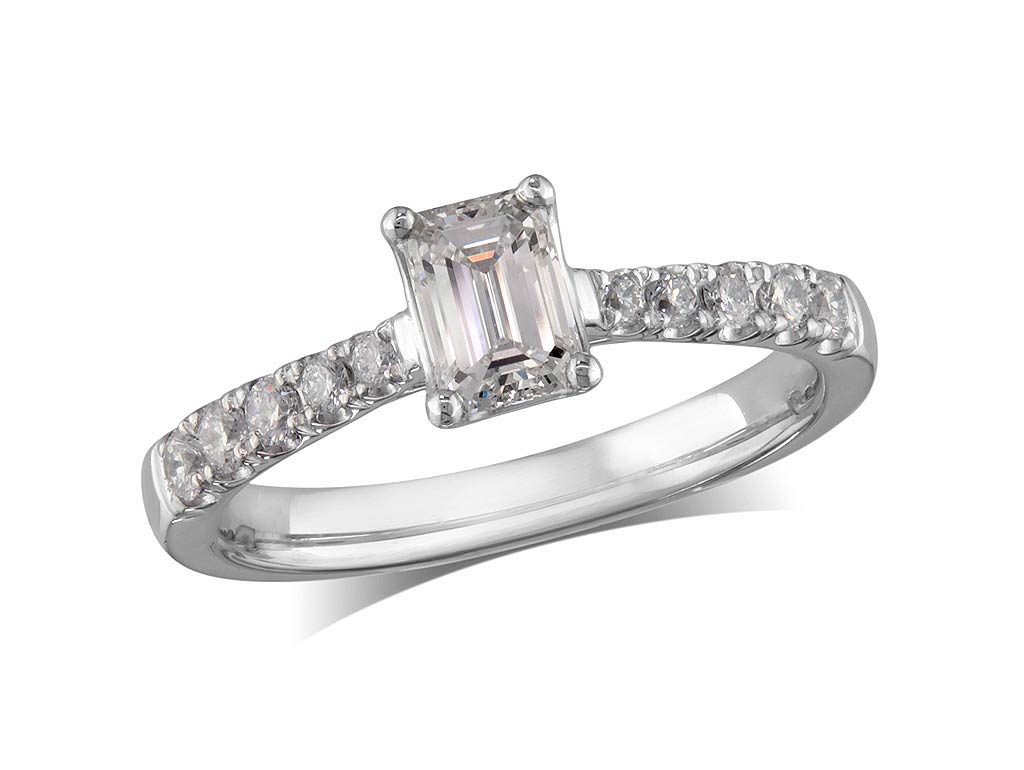 Platinum set single stone diamond engagement ring, with a certificated emerald cut centre in a four claw setting, and diamond set shoulders. Perfect fit with a wedding ring. Total diamond weight:0.68cts