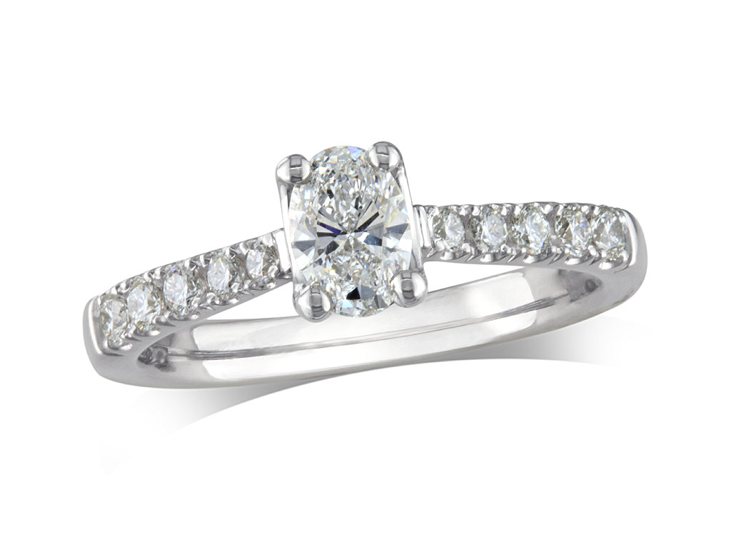 Platinum set single stone diamond engagement ring, with a certificated oval cut centre in a four claw setting, and diamond set shoulders. Perfect fit with a wedding ring. Total diamond weight: 0.57ct.