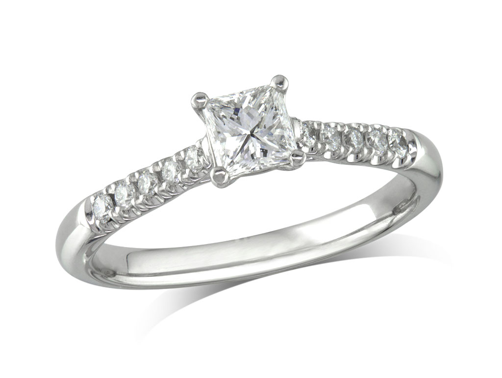 Platinum set single stone diamond engagement ring, with a certificated princess cut centre in a four claw setting, and diamond set shoulders. Perfect fit with a wedding ring. Total diamond weight: 0.58cts