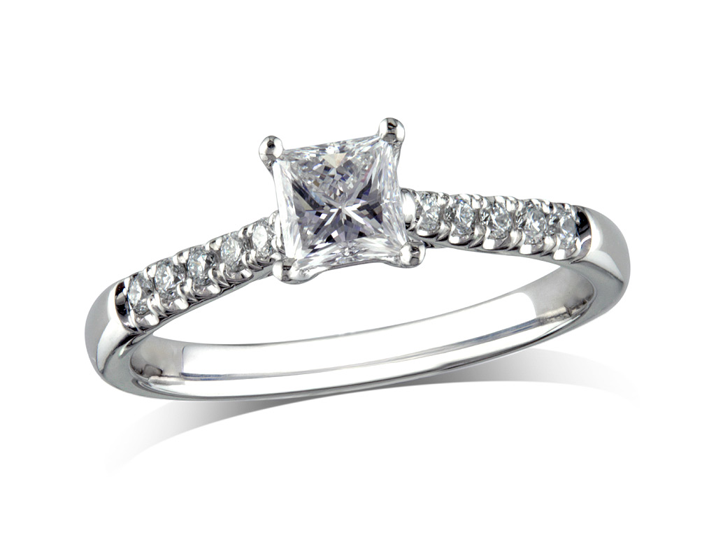 Platinum set single stone diamond engagement ring, with a certificated princess cut centre in a four claw setting, and diamond set shoulders. Perfect fit with a wedding ring. Total diamond weight: 0.72ct.