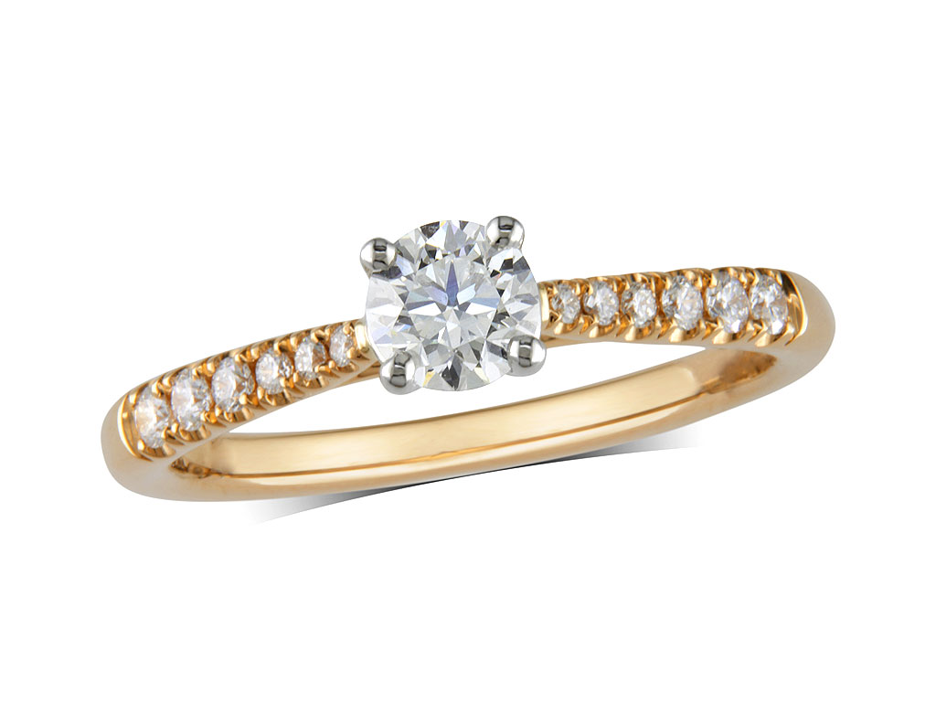 18ct yellow gold set single stone diamond engagement ring, with a certificated brilliant cut centre in a four claw setting, and diamond set shoulders. Perfect fit with a wedding ring. Total diamond weight: 0.55ct.