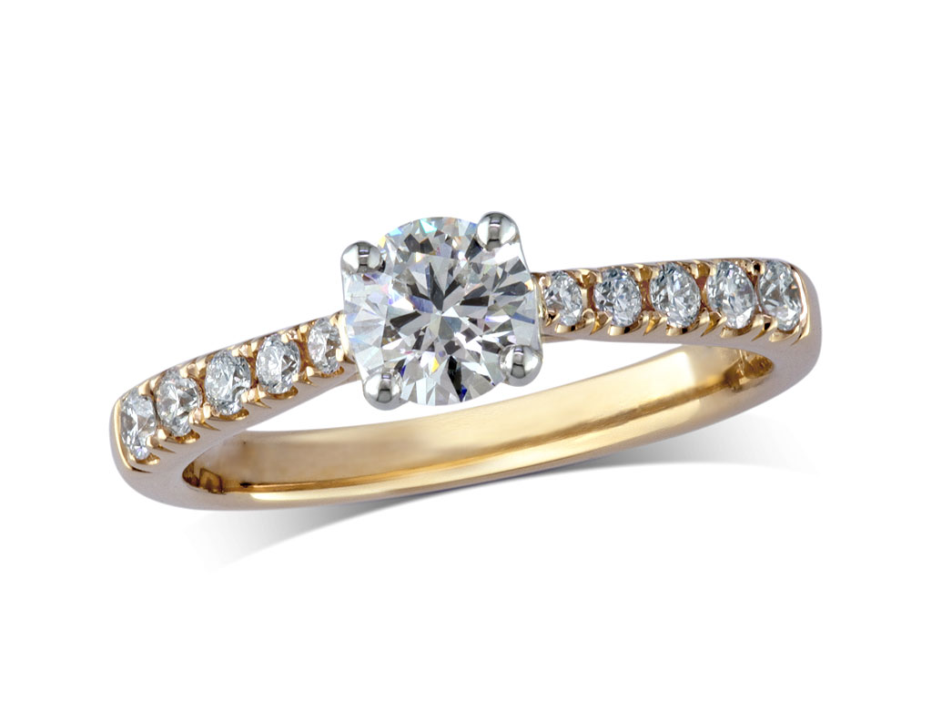 18 carat yellow gold set single stone diamond engagement ring, with a certificated brilliant cut centre in a four claw setting, and diamond set shoulders. Perfect fit with a wedding ring. Total diamond weight: 0.76ct.