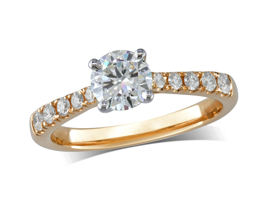 18ct yellow gold set single stone diamond engagement ring, with a certificated brilliant cut centre in a four claw setting, and diamond set shoulders. Perfect fit with a wedding ring. Total diamond weight: 0.96ct.