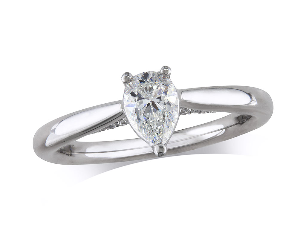 Platinum single stone diamond engagement ring, with a certificated pear cut, in a three claw setting. Perfect fit with a wedding ring.