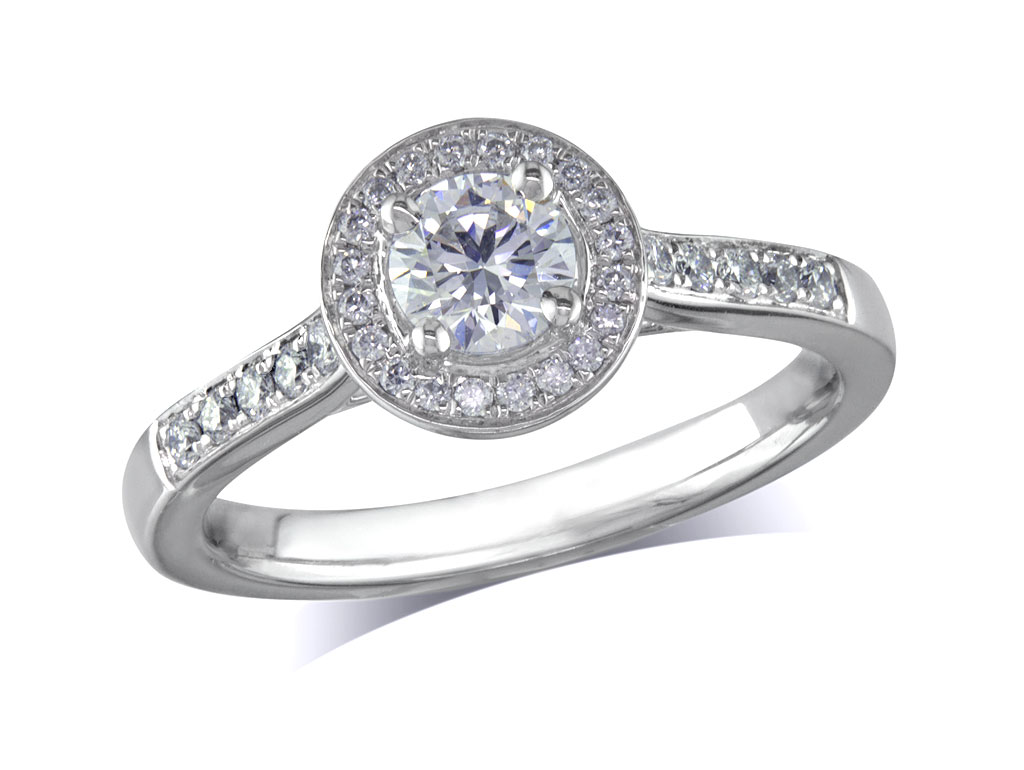 Platinum set diamond ring, with a certificated brilliant cut centre in a four claw setting, surrounded by a diamond set cluster and shoulders. Perfect fit with a wedding ring. Total diamond weight:0.64