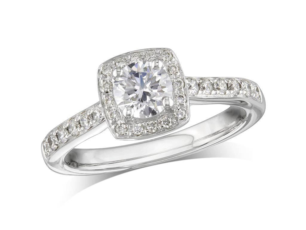 Platinum set diamond cluster engagement ring, with a certificated brilliant cut centre in a four claw setting, with a surrounding diamond set bezel and diamond set shoulders. Perfect fit with a wedding ring. Total cluster diamond weight: 0.79ct.