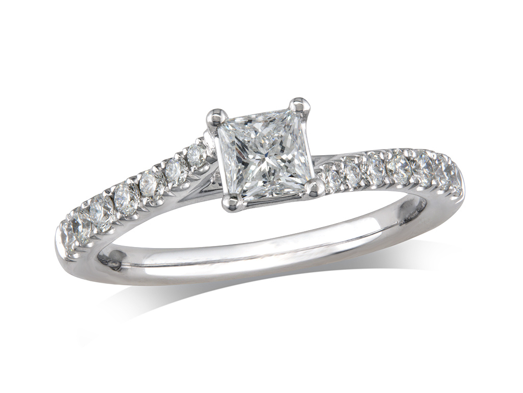 Platinum set single stone diamond engagement ring, with a certificated princess cut centre in a four claw setting, and diamond set shoulders. Total diamond weight: 0.92ct.