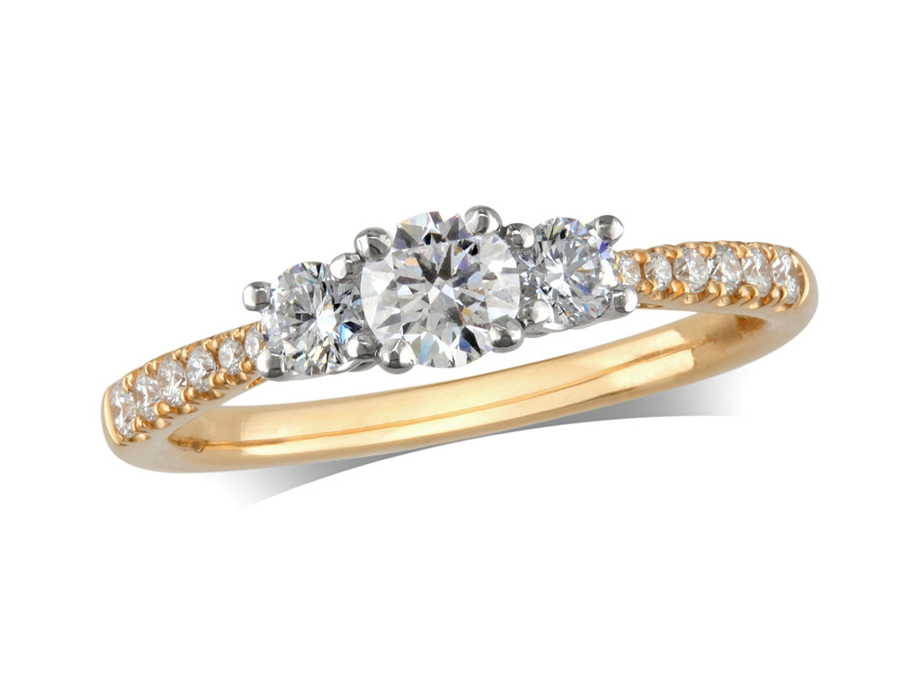 18 carat yellow gold set three stone diamond engagement ring, with a certificated brilliant cut centre in a four claw setting, and one brilliant cut with diamond set shoulders on each side. Perfect fit with a wedding ring. Total diamond weight: 0.85ct.
