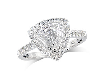Platinum set diamond ring, with a certificated trilliant cut centre in a 3 claw setting, surrounded by a diamond set cluster and shoulders. Perfect fit with a wedding ring. Total diamond weight: 0.97ct.