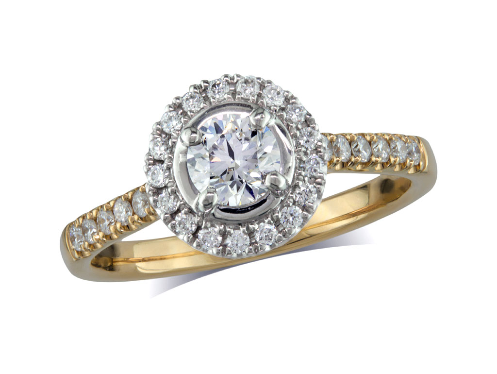 18 carat yellow gold set diamond ring, with a certificated brilliant cut centre in a four claw setting, surrounded by a diamond set cluster and shoulders. Perfect fit with a wedding ring. Total diamond weight: 0.78ct.