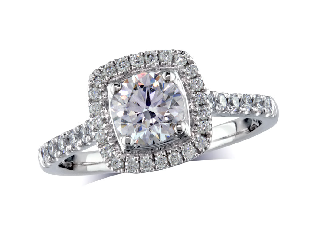 Platinum set diamond ring, with a certificated brilliant cut centre in a four claw setting, surrounded by a diamond set cluster and shoulders. Perfect fit with a wedding ring. Total diamond weight: 0.99ct.