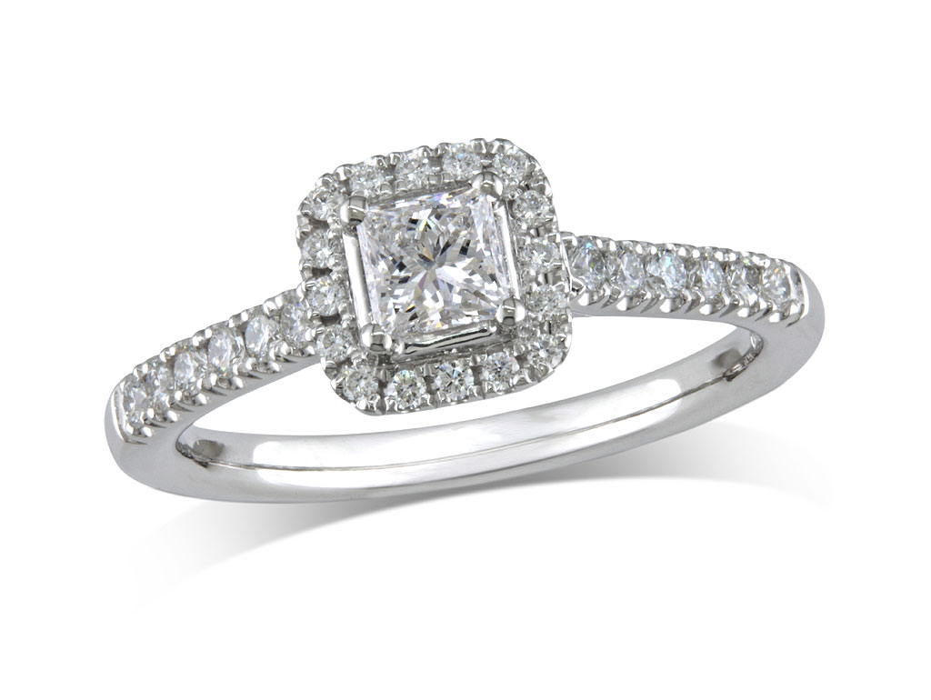 Platinum set diamond ring, with a certificated princess cut centre in a four claw setting, surrounded by a diamond set cluster and shoulders. Perfect fit with a wedding ring. Total diamond weight: 0.56ct.
