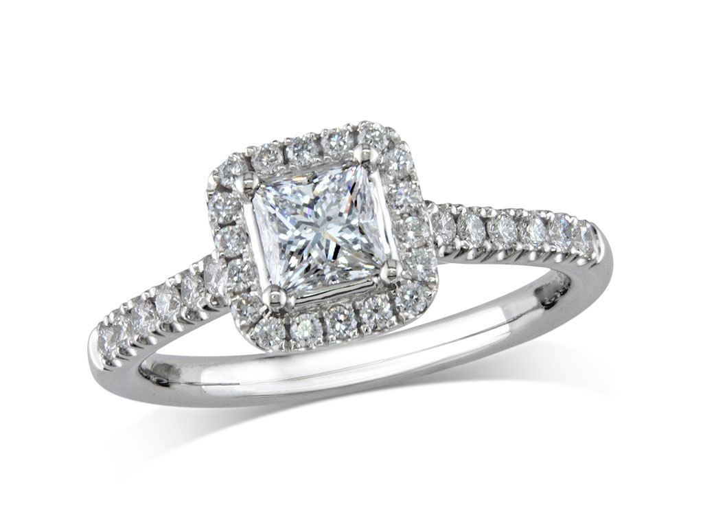 Platinum set diamond ring, with a certificated princess cut centre in a four claw setting, surrounded by a diamond set cluster and shoulders. Perfect fit with a wedding ring. Total diamond weight: 0.83ct.