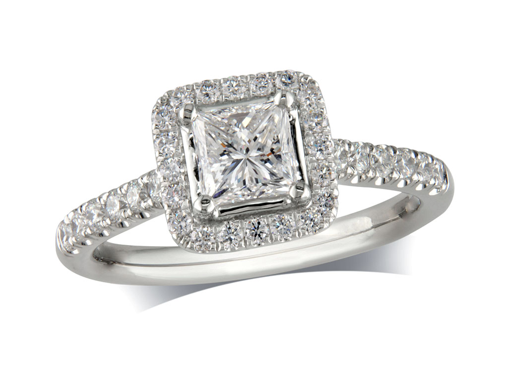 Platinum set diamond cluster engagement ring, with a certificated princess cut centre in a four claw setting, with a surrounding diamond set bezel and diamond set shoulders. Perfect fit with a wedding ring. Total cluster diamond weight: 1.09ct.
