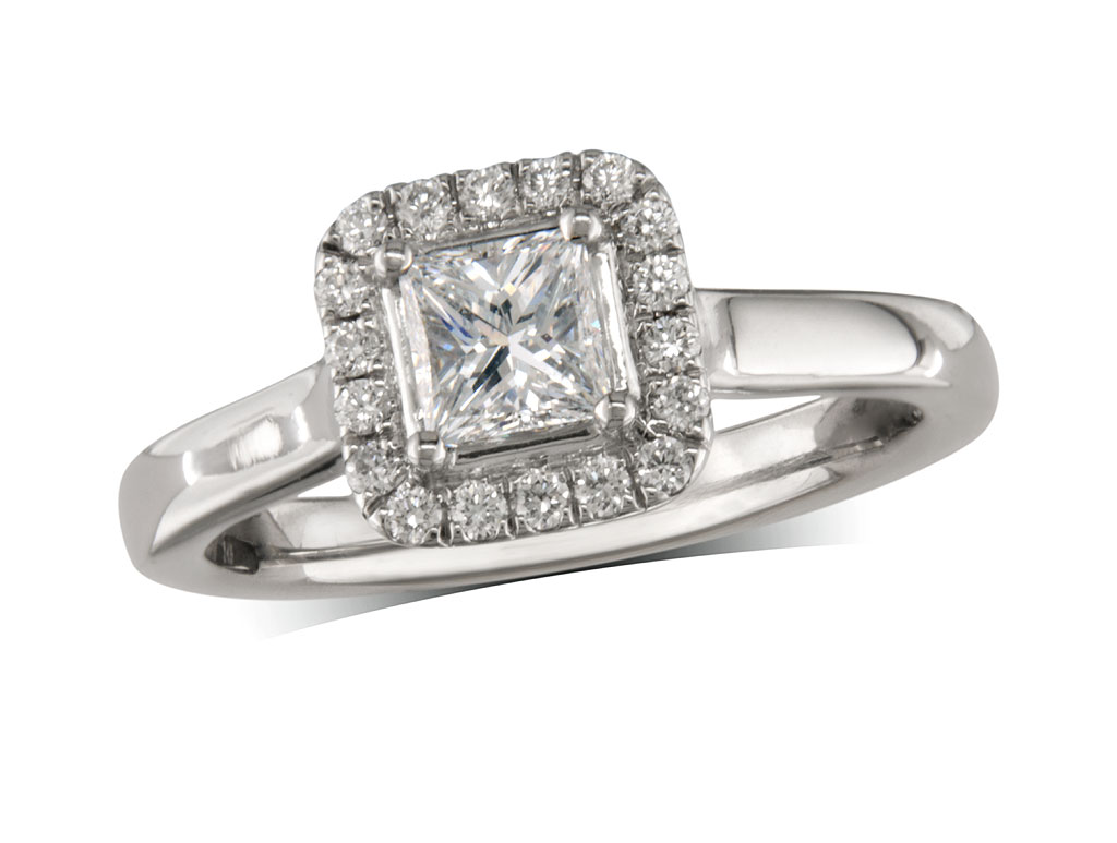 Platinum set diamond ring, with a certificated princess cut centre in a four claw setting, surrounded by a diamond set cluster. Perfect fit with a wedding ring. Total diamond weight: 0.52ct.