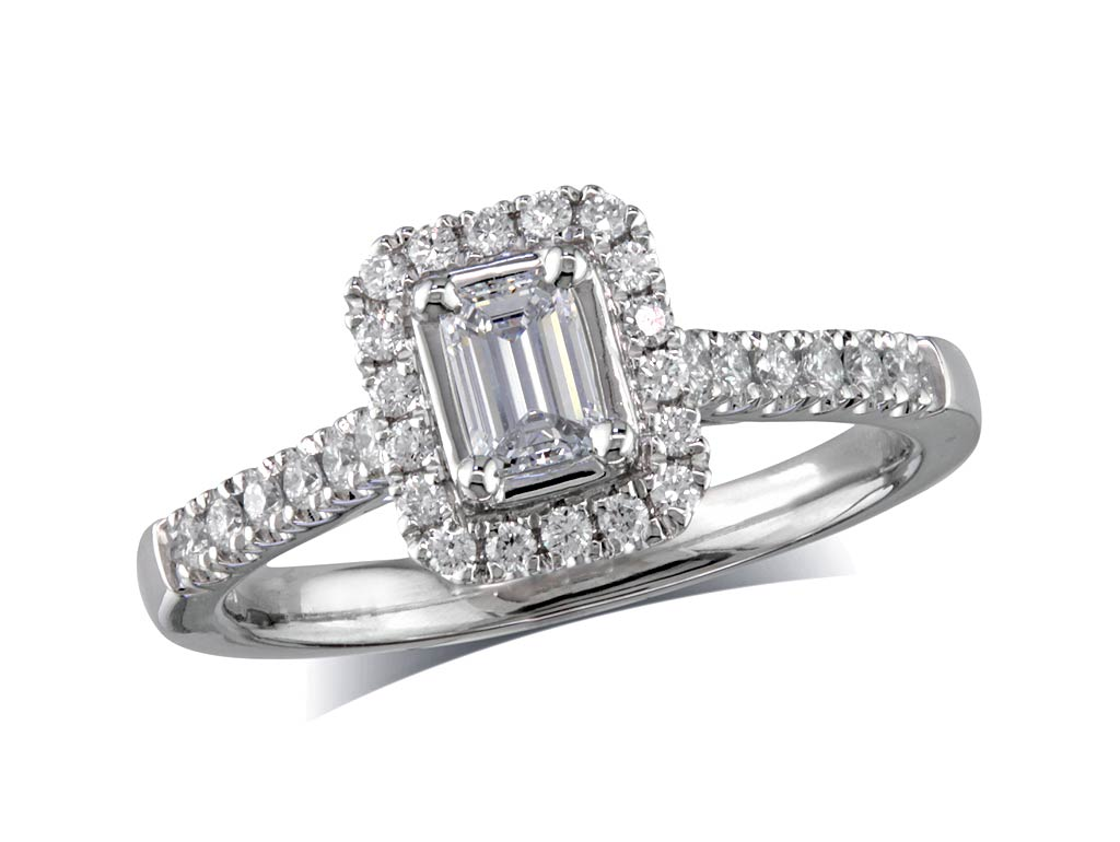Platinum set diamond cluster engagement ring, with a certificated emerald cut centre in a four claw setting, with a surrounding diamond set bezel and diamond set shoulders. Perfect fit with a wedding ring. Total cluster diamond weight: 0.70
