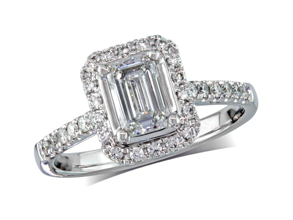 Platinum set diamond cluster engagement ring, with a certificated emerald cut centre in a four claw setting, with a surrounding diamond set bezel and diamond set shoulders. Perfect fit with a wedding ring. Total cluster diamond weight:  1.00ct