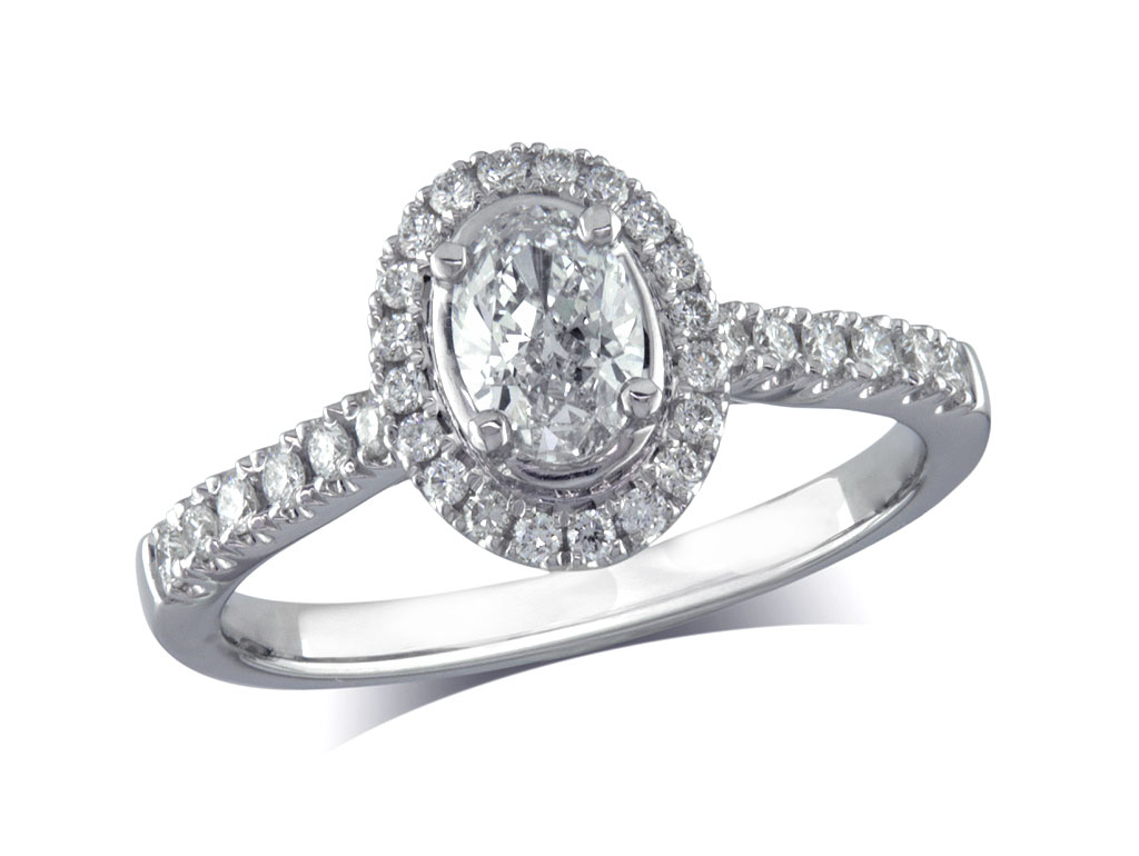 Platinum set diamond ring, with a certificated oval cut centre in a four claw setting, surrounded by a diamond set cluster and shoulders. Perfect fit with a wedding ring. Total diamond weight:0.60