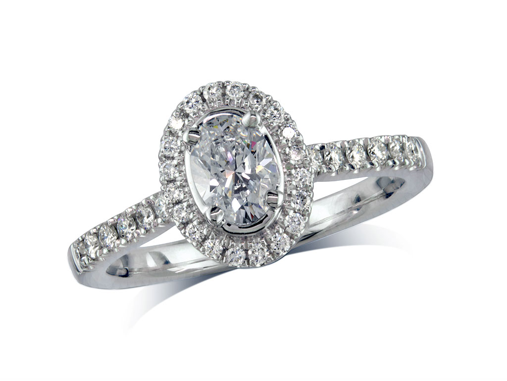 Platinum set diamond cluster engagement ring, with a certificated oval cut centre in a four claw setting, with a surrounding diamond set bezel and diamond set shoulders. Perfect fit with a wedding ring. Total cluster diamond weight: 0.84ct.