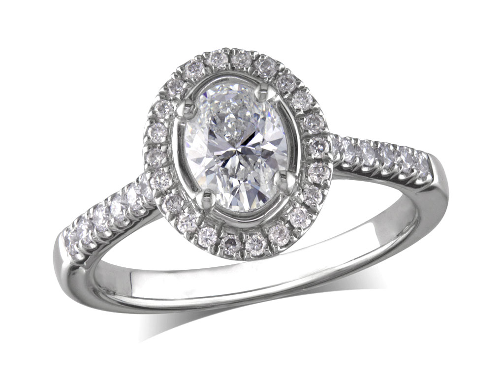 Platinum set diamond ring, with a certificated oval cut centre in a four claw setting, surrounded by a diamond set cluster and shoulders. Perfect fit with a wedding ring. Total diamond weight: 0.85ct