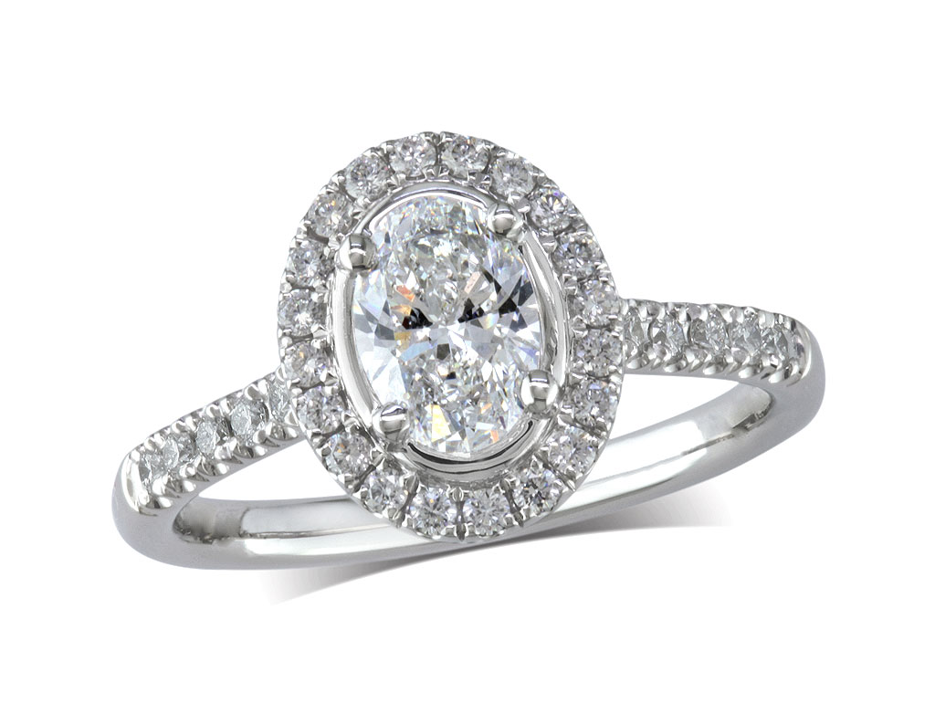 Platinum set diamond cluster engagement ring, with a certificated oval cut centre in a four claw setting, with a surrounding diamond set bezel and diamond set shoulders. Perfect fit with a wedding ring. Total cluster diamond weight: 1.10ct.