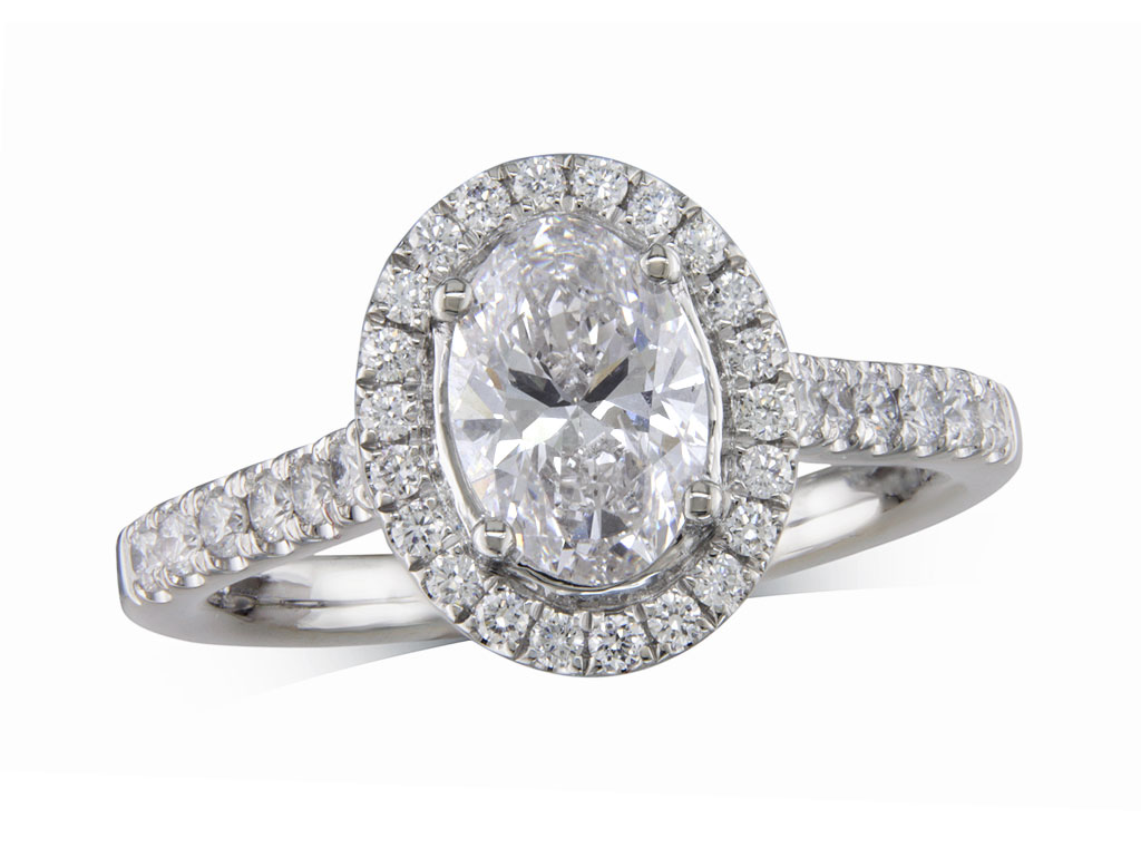 Platinum set diamond cluster engagement ring, with a certificated oval cut centre in a four claw setting, with a surrounding diamond set bezel and diamond set shoulders. Perfect fit with a wedding ring. Total cluster diamond weight: 1.40ct.