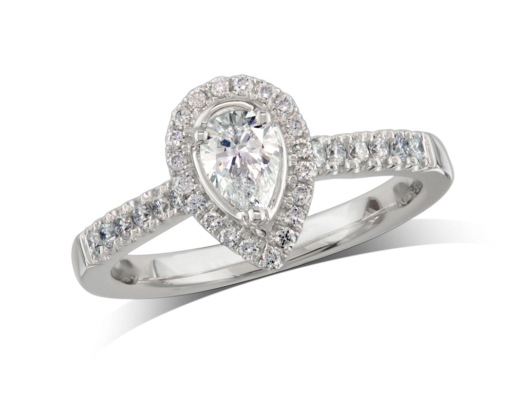 Platinum set diamond ring, with a certificated pear cut centre in a three claw setting, surrounded by a diamond set cluster and shoulders. Perfect fit with a wedding ring. Total diamond weight: 0.58ct.