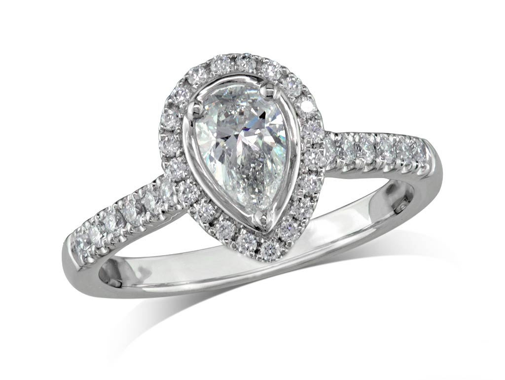 Platinum set diamond ring, with a certificated pear cut centre in a three claw setting, surrounded by a diamond set cluster and shoulders. Perfect fit with a wedding ring. Total diamond weight: 0.80ct.