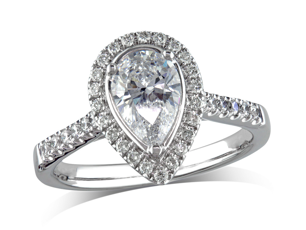 Platinum set diamond ring, with a certificated pear cut centre in a three claw setting, surrounded by a diamond set cluster and shoulders. Perfect fit with a wedding ring. Total diamond weight: 1.31ct.