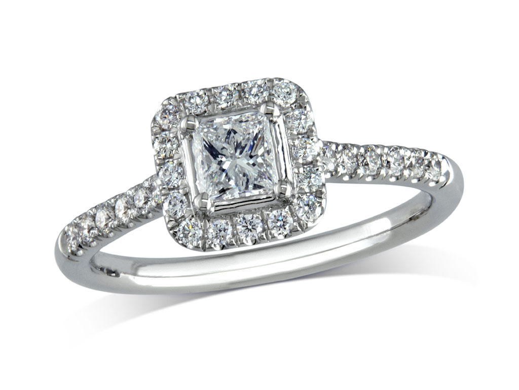 Platinum set diamond ring, with a certificated princess cut centre in a four claw setting, surrounded by a diamond set cluster and shoulders. Perfect fit with a wedding ring. Total diamond weight: 0.67ct.