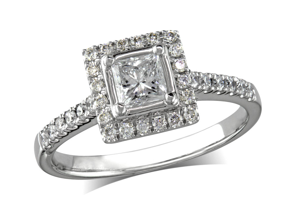 Platinum set diamond engagement ring, with a certificated princess cut centre in a four claw setting, surrounded by a diamond set cluster and shoulders. Perfect fit with a wedding ring. Total diamond weight:  0.72ct