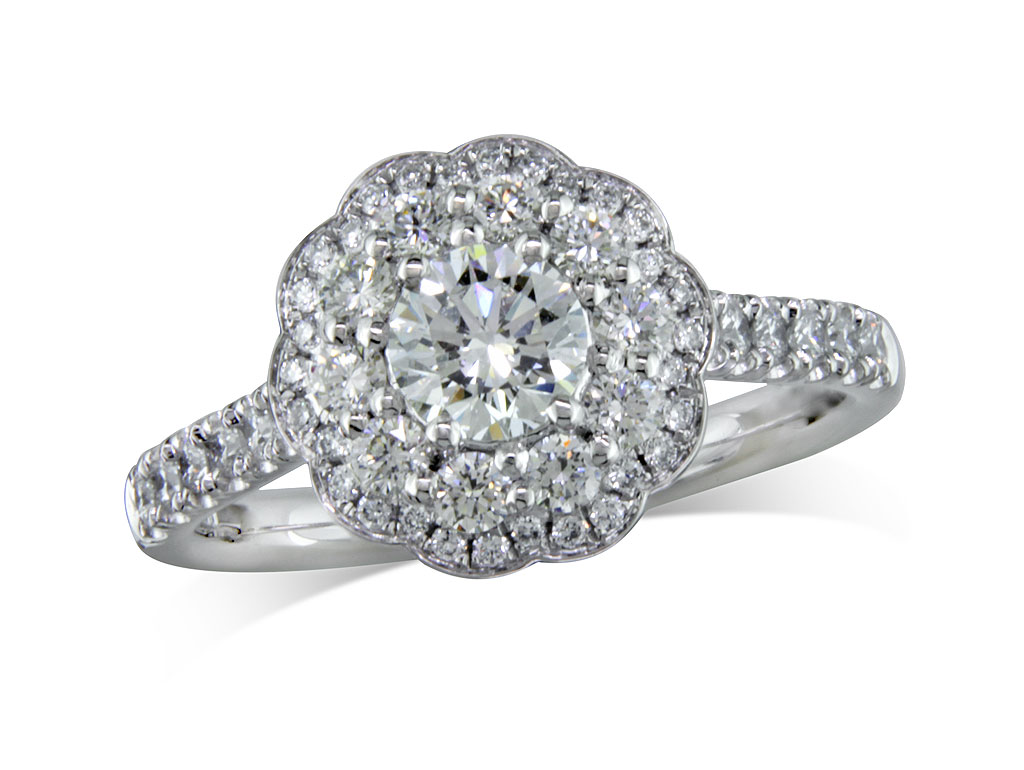 Platinum diamond cluster engagement ring, with a certificated brilliant cut centre in a claw setting, with a surrounding row of brilliant cut diamonds and a diamond set bezel and diamond set shoulders. Total cluster diamond weight: 0.98ct.
