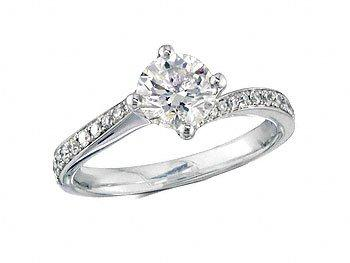 Platinum set single stone diamond engagement ring, with a certificated brilliant cut centre in a four claw setting, and diamond set shoulders. Perfect fit with a wedding ring. Total diamond weight: 1.12ct.