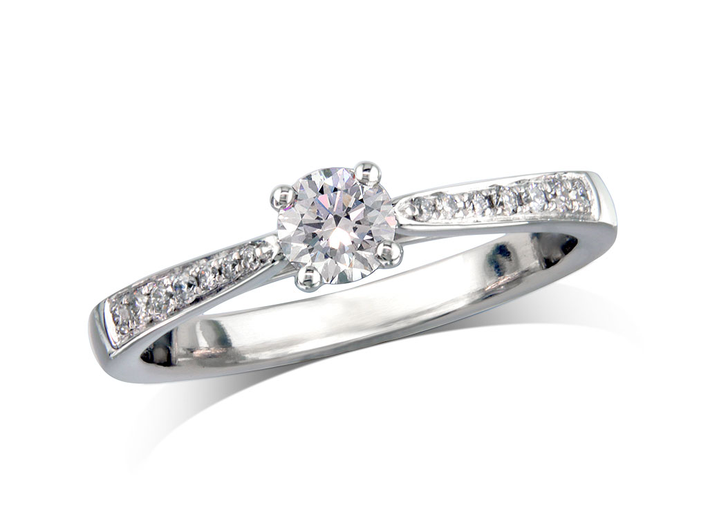 Platinum set single stone diamond engagement ring, with a certificated brilliant cut centre in a four claw setting, and diamond set shoulders. Perfect fit with a wedding ring. Total diamond weight: 0.42ct.