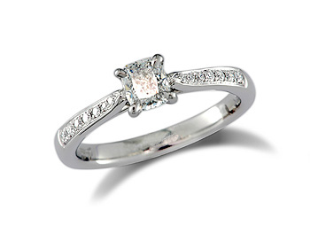 Platinum set single stone diamond engagement ring, with a certificated cushion cut centre in a four claw setting, and diamond set shoulders. Perfect fit with a wedding ring. Total diamond weight: 0.60ct.