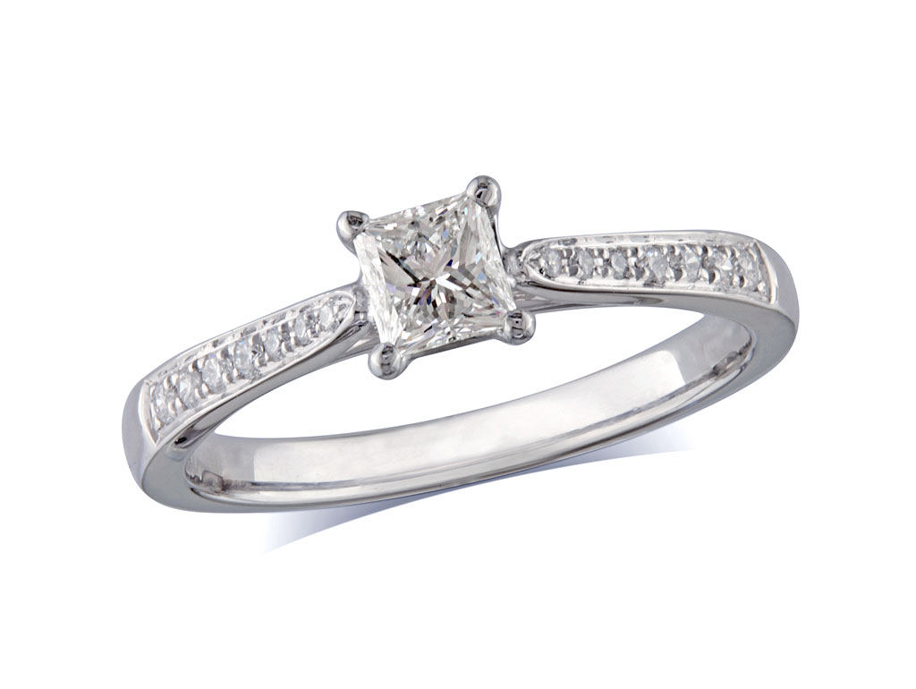 Platinum set single stone diamond engagement ring, with a certificated princess cut centre in a four claw setting, and diamond set shoulders. Perfect fit with a wedding ring. Total diamond weight:0.56