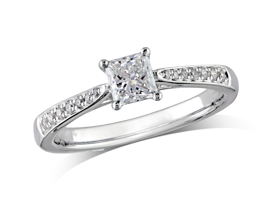 Platinum set single stone diamond engagement ring, with a certificated princess cut centre in a four claw setting, and diamond set shoulders. Perfect fit with a wedding ring. Total diamond weight: 0.74cts