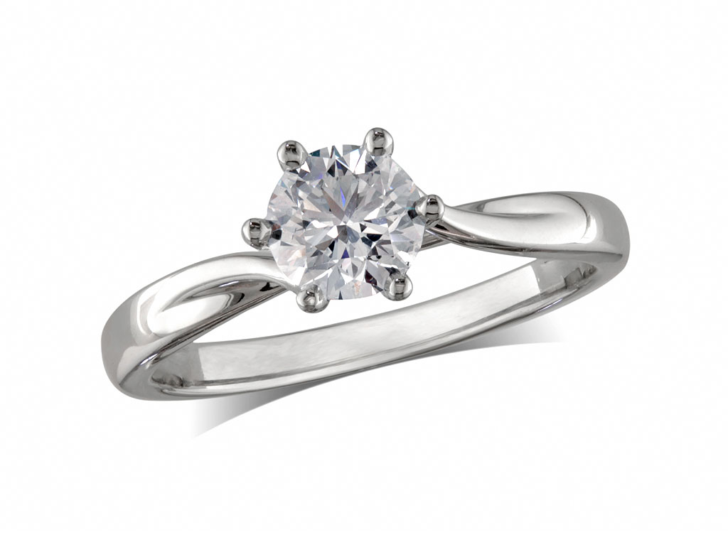 Platinum set single stone diamond engagement ring, with a certificated brilliant cut, in a six claw setting. Perfect fit with a wedding ring.