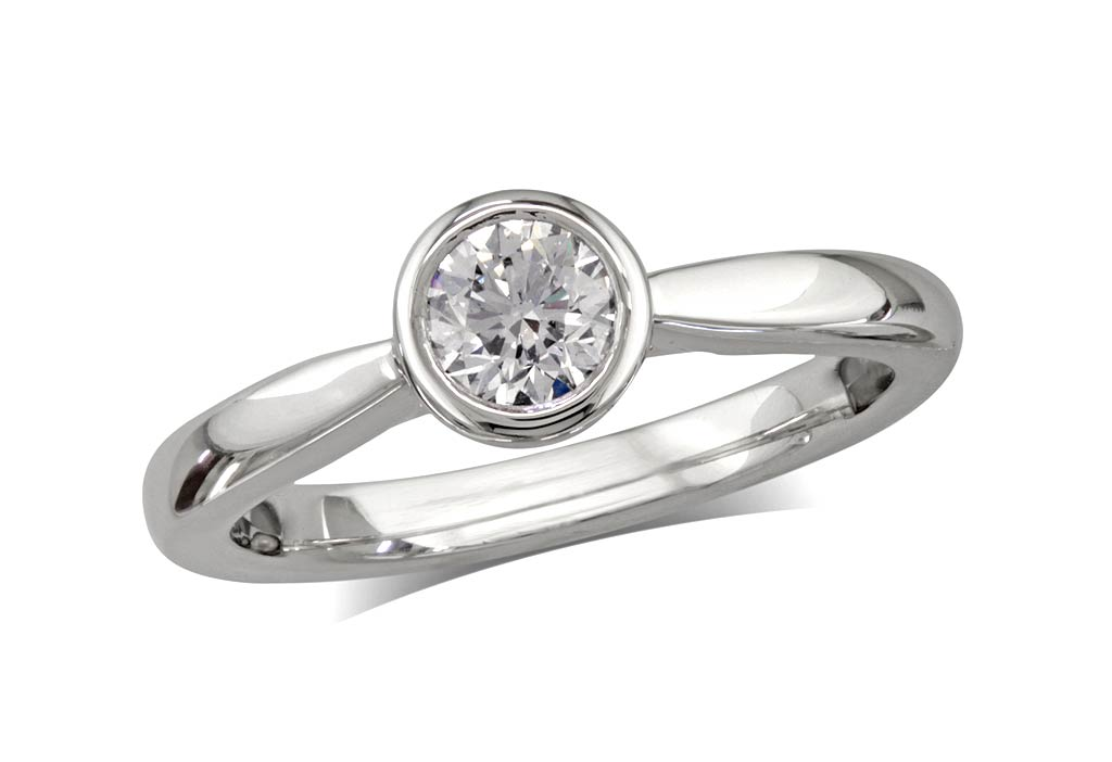 Platinum set single stone diamond engagement ring, with a certificated brilliant cut, in a rub-over setting. Perfect fit with a wedding ring.