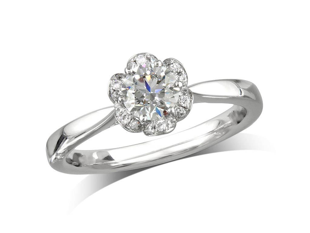 A 0.52ct centre, Brilliant, G, Cluster diamond ring. You can buy online or reserve online and view in store at Jamieson and Carry, Aberdeen