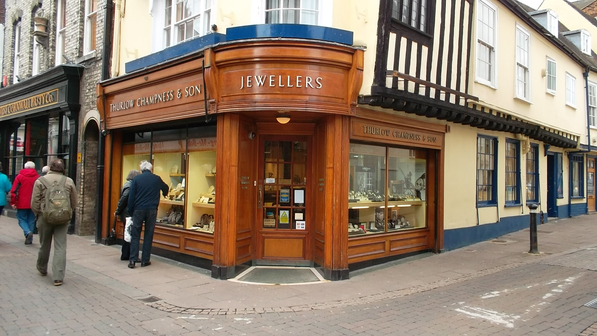 Thurlow Champness Jewellers has been providing the very best in luxury goods for over 100 years. We are located in the heart of historic Bury St Edmunds, 'under the clock' in Abbeygate Street, a short distance from the town centre and on route to the famous Abbey Gardens. The main shop carries a wide range of prestige brand names, such as Rolex, Bremont, Longines, Citizen, Portfolio of Fine Diamonds, Mikimoto, Fope, Georg Jensen, Marco Bicego, SHO Fine Jewellery, Links of London, Thomas Sabo, Rachel Galley, Babette Wasserman, Baccarat, Breuning and Lalique..