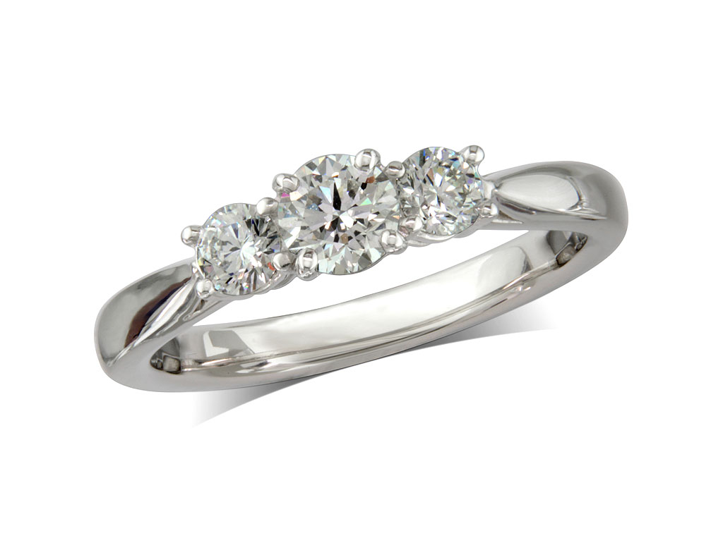 Platinum set three stone diamond engagement ring, with a certificated brilliant cut centre in a four claw setting, and one brilliant cut on each shoulder. Perfect fit with a wedding ring. Total diamond weight: 0.47ct.