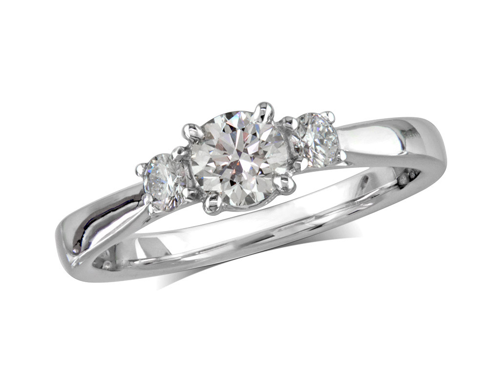 Platinum set three stone diamond engagement ring, with a certificated brilliant cut centre in a four claw setting, and one brilliant cut on each shoulder. Perfect fit with a wedding ring. Total diamond weight: 0.63ct.