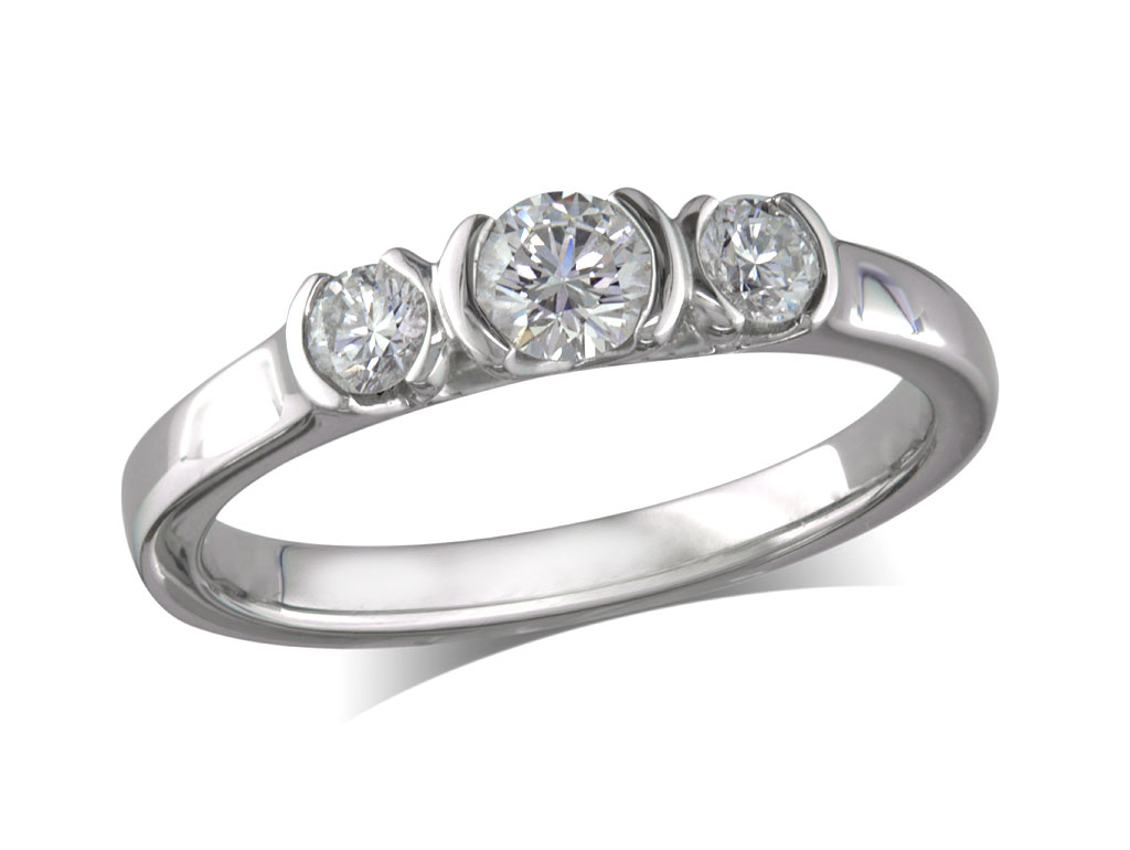 Platinum set three stone diamond engagement ring, with a certificated brilliant cut centre in a half rub over setting, and one brilliant cut on each shoulder. Perfect fit with a wedding ring. Total diamond weight: 0.46ct.