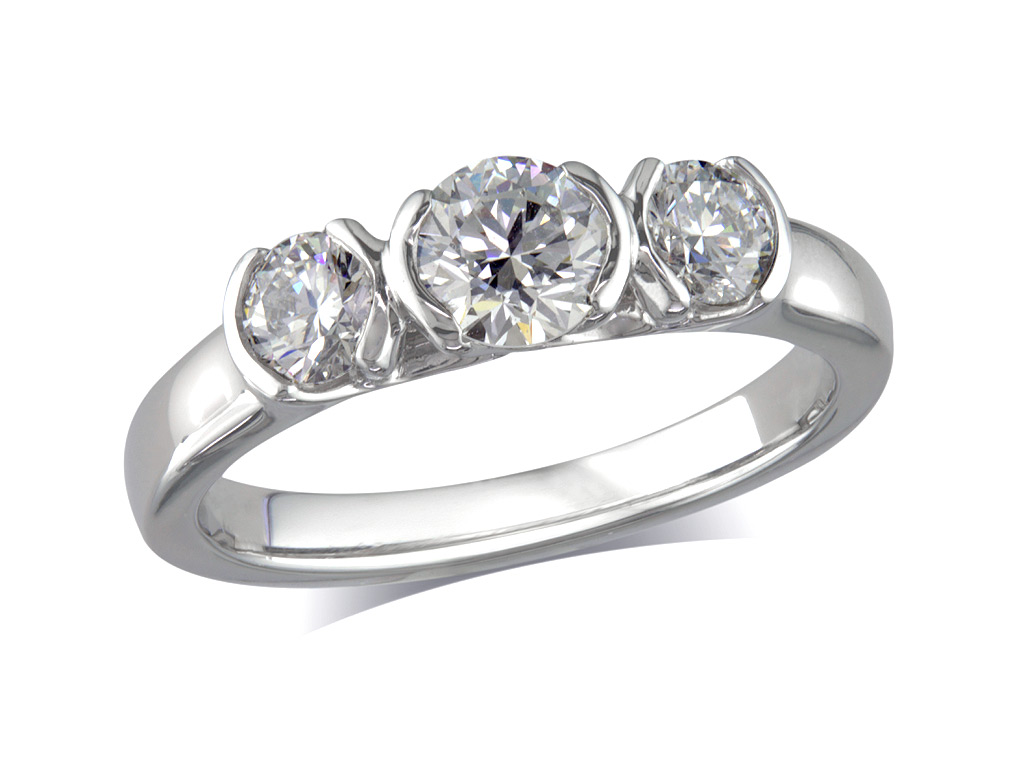 Platinum set three stone diamond engagement ring, with a certificated brilliant cut centre in a half rub over setting, and one brilliant cut on each shoulder. Perfect fit with a wedding ring. Total diamond weight: 1.01ct.