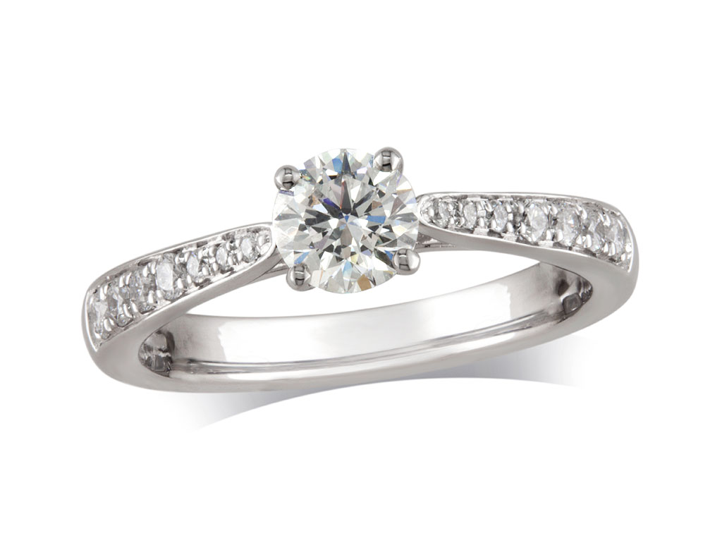 Platinum set single stone diamond engagement ring, with a certificated brilliant cut centre in a four claw setting, and diamond set shoulders. Perfect fit with a wedding ring. Total diamond weight: 0.71ct.
