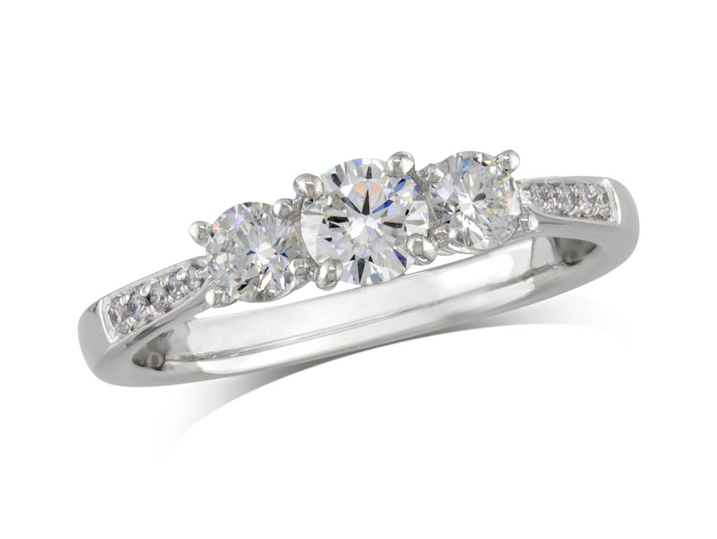 Platinum set three stone diamond engagement ring, with a certificated brilliant cut centre in a four claw setting, and one brilliant cut with diamond set shoulders on each side. Perfect fit with a wedding ring. Total diamond weight: 0.67ct.