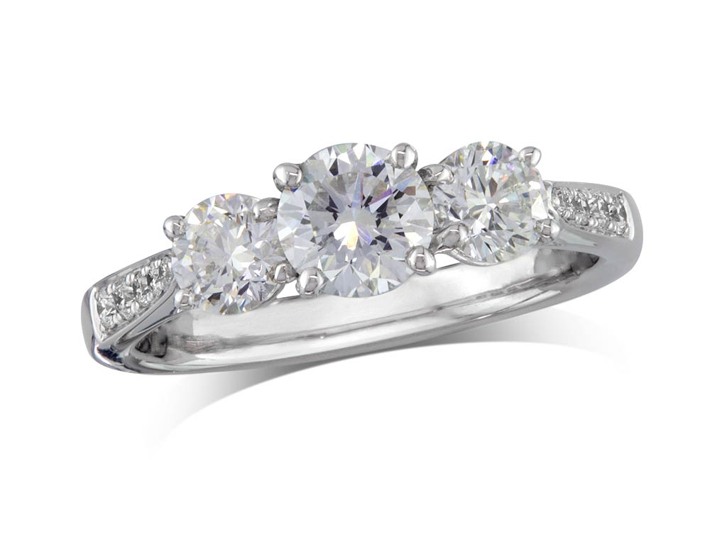 Platinum set three stone diamond engagement ring, with a certificated brilliant cut centre in a four claw setting, and one brilliant cut with diamond set shoulders on each side. Perfect fit with a wedding ring. Total diamond weight: 1.50ct.
